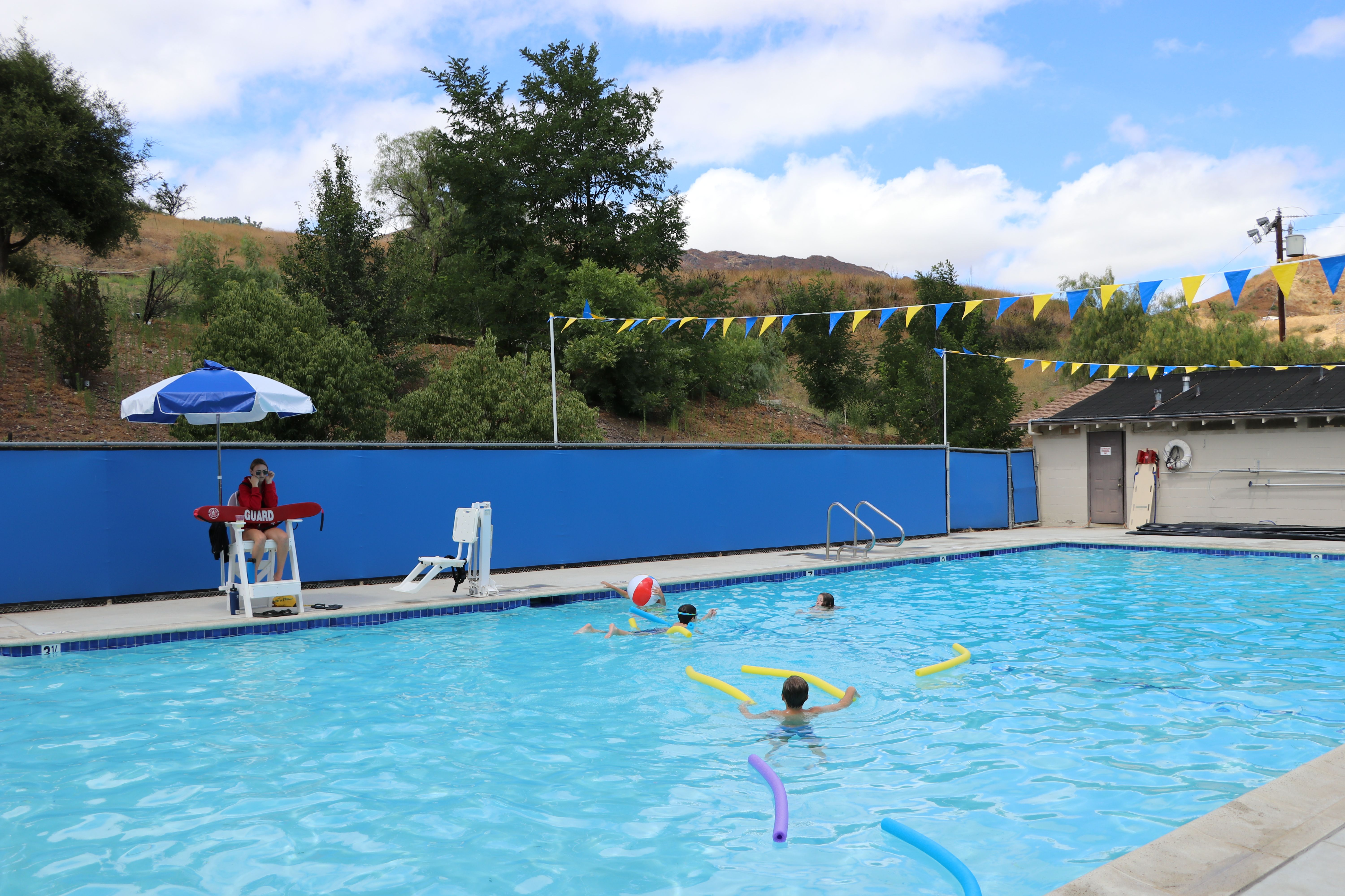 children's swim camp with waterslide